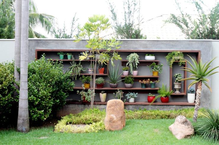Vườn phong cách nhiệt đới bởi RABAIOLI I FREITAS Nhiệt đới Gỗ Wood effect